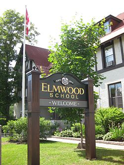 Picture Description A photo of Elmwood School, Ottawa including the exterior of the building and the school sign. Author: Pactumserva